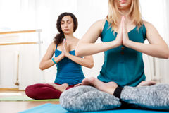 Cute girl practice yoga, meditating and relaxing in Lotus position Royalty Free Stock Images