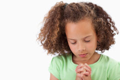 Cute girl praying Royalty Free Stock Images