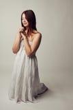 Cute girl praying Stock Image