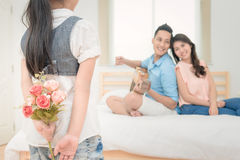 Cute girl prepare flowers to surprise her parent Royalty Free Stock Images