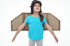 Cute girl pretending to be pilot. Cute girl with fake wings pretending to be pilot on white screen Royalty Free Stock Images