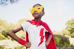 Cute girl pretending to be superhero with hands on hip Royalty Free Stock Photo
