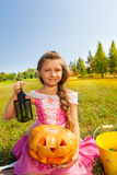 Cute girl in princess costume sits with pumpkin Stock Image
