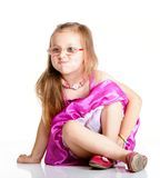 A cute girl puffs up her cheeks  Royalty Free Stock Photography