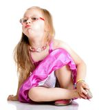 A cute girl puffs up her cheeks isolated Royalty Free Stock Photography