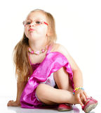 A cute girl puffs up her cheeks isolated Royalty Free Stock Images
