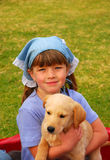 Cute girl with puppy dog Royalty Free Stock Photography
