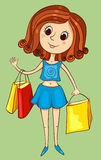 Cute girl with purchases Royalty Free Stock Photos