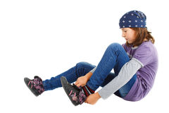 Cute girl putting on her shoe Stock Photo