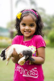 Cute girl with a rabbit. Royalty Free Stock Photo
