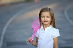 Cute girl with racket Royalty Free Stock Images