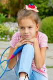 Cute girl with racket Outdoors Royalty Free Stock Photo