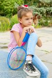 Cute girl with racket Outdoors Royalty Free Stock Photography