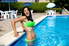 Cute girl reaction while entering in swimming pool with cold water Stock Photography