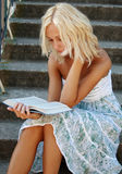 Cute girl reading a book Stock Image