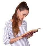 Cute girl reading a book Stock Photo
