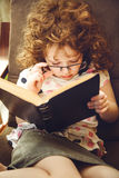 Cute girl reading a book. Stock Photography