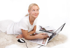 Cute girl reading magazine and dreaming Stock Photo