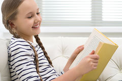Cute girl reading. Royalty Free Stock Photography