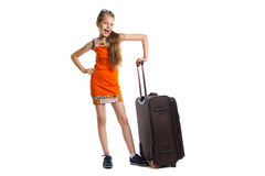 Cute girl ready for summer vacation. Joyful girl with luggage bag about to travel. Isolation on a white background Stock Photo
