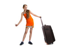 Cute girl ready for summer vacation. Joyful girl with luggage bag about to travel. Isolation on a white background Royalty Free Stock Image