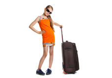 Cute girl ready for summer vacation. Joyful girl with luggage bag about to travel Stock Photography