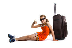Cute girl ready for summer vacation. Joyful girl with luggage bag about to travel Royalty Free Stock Photo