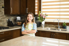 Cute girl ready to cook some food Stock Photos