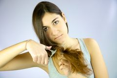 Cute girl ready to cut her long hair Royalty Free Stock Images