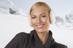 Cute girl ready for the winter cold day smiling Royalty Free Stock Photos