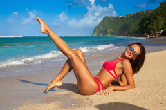 Cute girl in red bikini walking at tropical beach bali. Posing lying on the sand Stock Photos