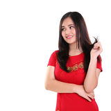 Cute girl in red cheongsam looking sideways isolated stock photography
