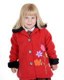 Cute girl in red coat Stock Photography