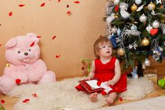 Cute girl in red dress. Cute little girl in red princess dress Stock Photo