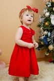 Cute girl in red dress. Portrait of cute little girl in red princess dress Royalty Free Stock Photography