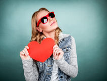 Cute girl with red heart Stock Photos