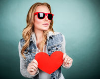 Cute girl with red heart Stock Images