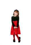 Cute girl in red holiday dress Stock Photos
