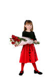 Cute girl in red holiday dress Royalty Free Stock Image