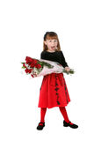 Cute girl in red holiday dress with roses Stock Images