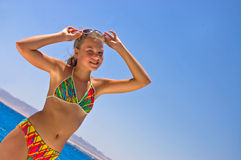 Cute girl at the red sea Royalty Free Stock Photo