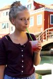 Cute girl with red slush drink Stock Image