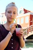Cute girl with red slush drink Stock Photos