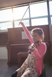 Cute girl rehearsing violin in music class Royalty Free Stock Images