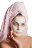 Cute girl in a rejuvenating mask Royalty Free Stock Photos