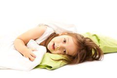 Cute girl relaxing in bed. Little girl on her bed early in the morning Royalty Free Stock Photo