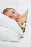 Cute girl relaxing with her teddy bear Royalty Free Stock Image