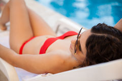 Cute girl relaxing by the pool Stock Image