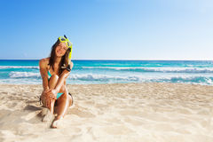 Cute girl relaxing after scuba diving Stock Image