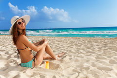 Cute girl relaxing on white sand beach Royalty Free Stock Photo